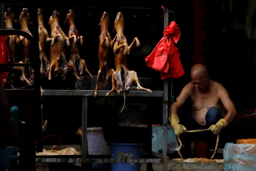 In a photo from June 21, 2018, butchered dogs are displayed for sale at a stall inside a meat market during the local dog meat festival in Yulin, Guangxi Zhuang Autonomous Region, China.