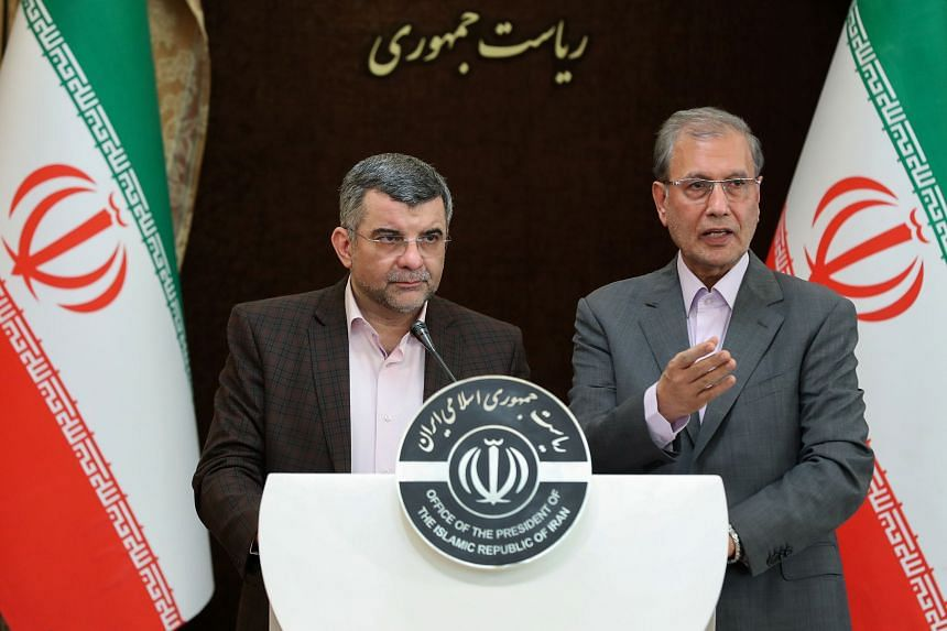 Iran's deputy health minister Iraj Harirchi (left) coughed occasionally and appeared to be sweating during a press conference with government spokesman Ali Rabiei on Feb 24, 2020.