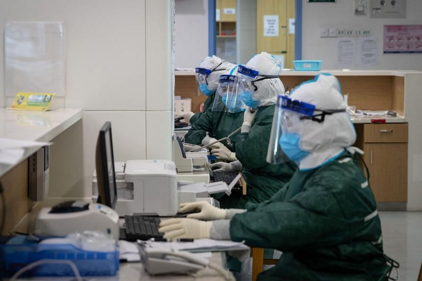Medical staff working at a hospital in Wuhan on Feb 22, 2020.