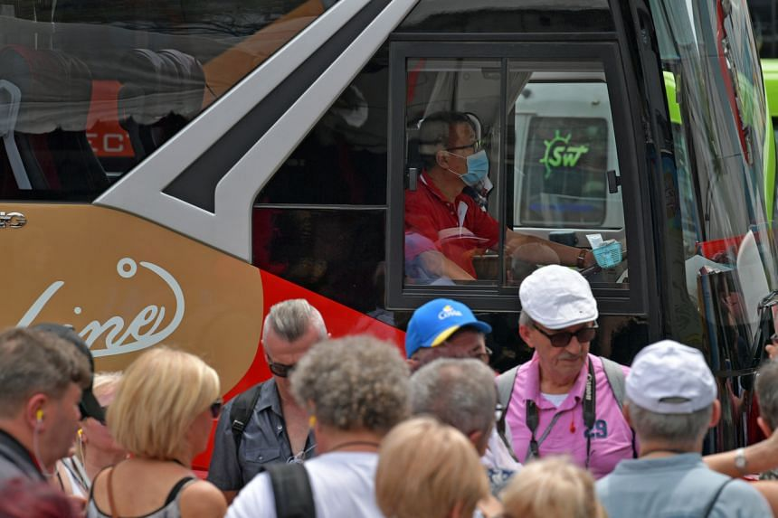 A tour bus driver is seen wearing a mask as he picks up tourists outside the Buddha Tooth Relic Temple & Museum in Chinatown on Feb 4, 2020.