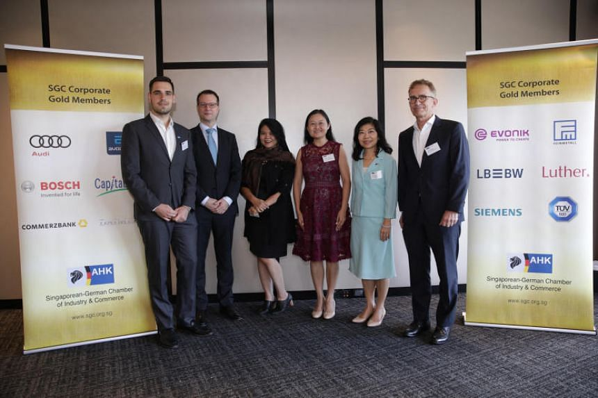 (From left) Robin Hoenig, senior consultant for trade policies at the Singaporean-German Chamber of Industry and Commerce (SGC), SGC president Claus Trenner, Sin Hwa Dee Foodstuff Industries managing director Jocelyn Chng, Acumen Research Laboratorie