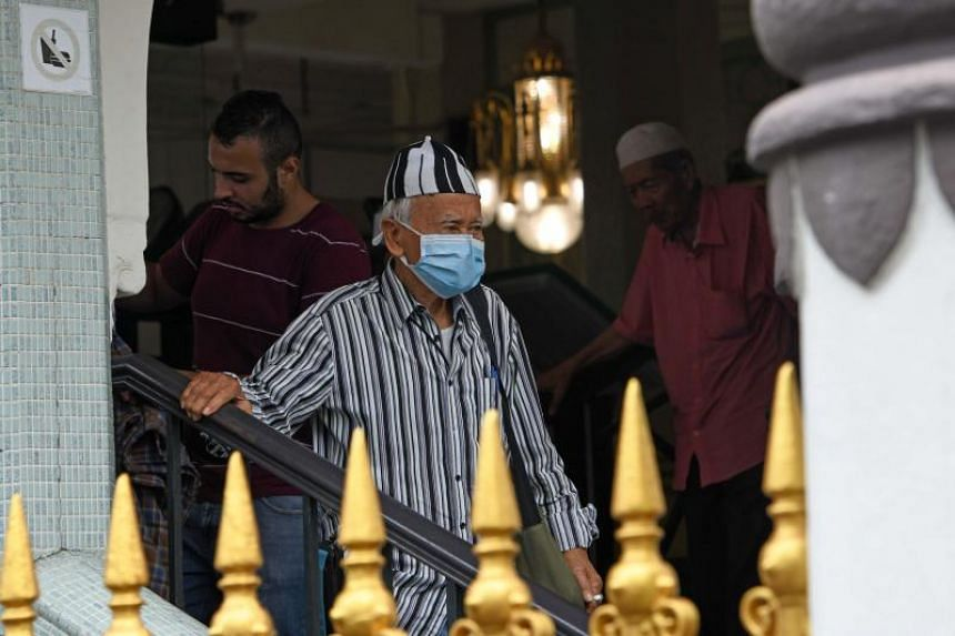 A man wearing a protective face mask leaves a mosque in Singapore on Feb 21, 2020. Both online and mosque collections will end on March 5.
