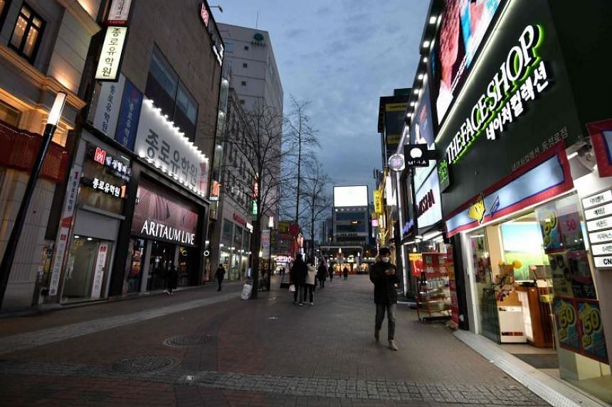 Pedestrians in the Dongseongro shopping district in Daegu, South Korea, on Feb 24, 2020.