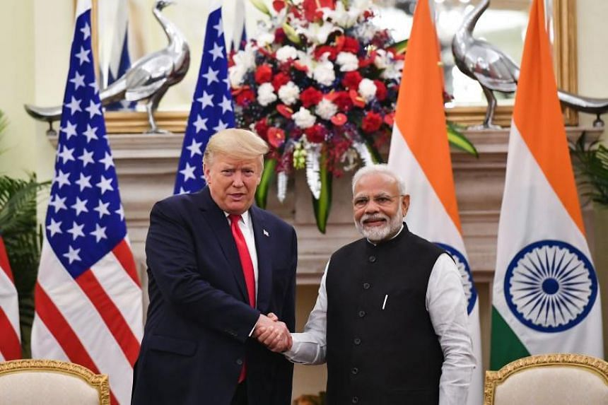 India's Prime Minister Narendra Modi (right) shakes hands with US President Donald Trump during a meeting at Hyderabad House in New Delhi, India, on Feb 25, 2020.