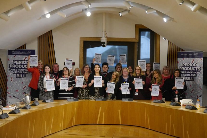 The Period Products (Free Provision) Scotland Bill was proposed by Scottish lawmaker Monica Lennon (front row, fourth from left), who first submitted a draft proposal in 2017.