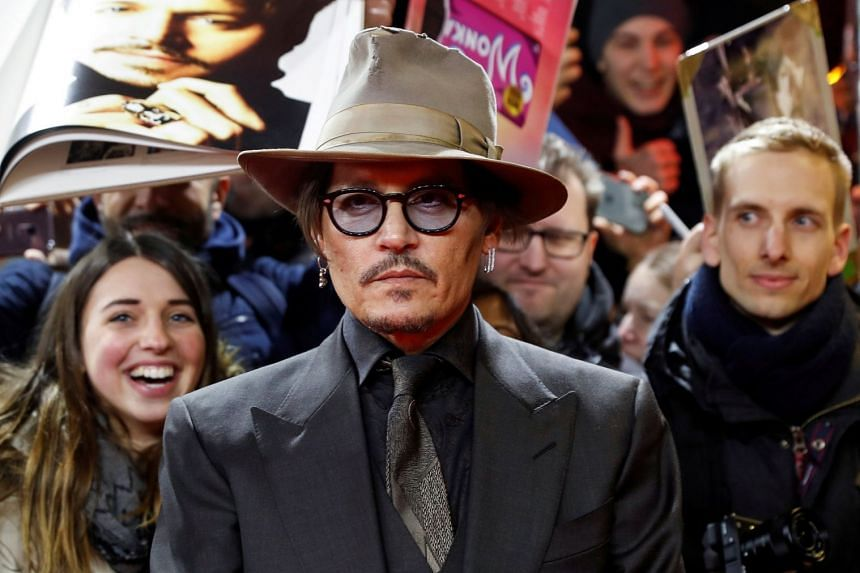 Johnny Depp poses on the red carpet as he arrives for the screening of the movie Minamata during the 70th Berlinale International Film Festival on Feb 21, 2020.