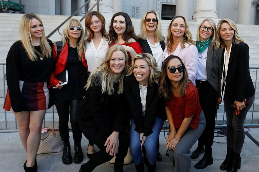 (From left) Jessica Barth, Rossanna Arquette, Lauren O'Connor, Caitlin Dulany, Sarah Ann Masse, Louise Godbold, Lauran Sivan, Louisette Geiss, Larissa Gomes, Melissa Sagemiller Nesic and Katherine Kendall pose for a group picture following a news con