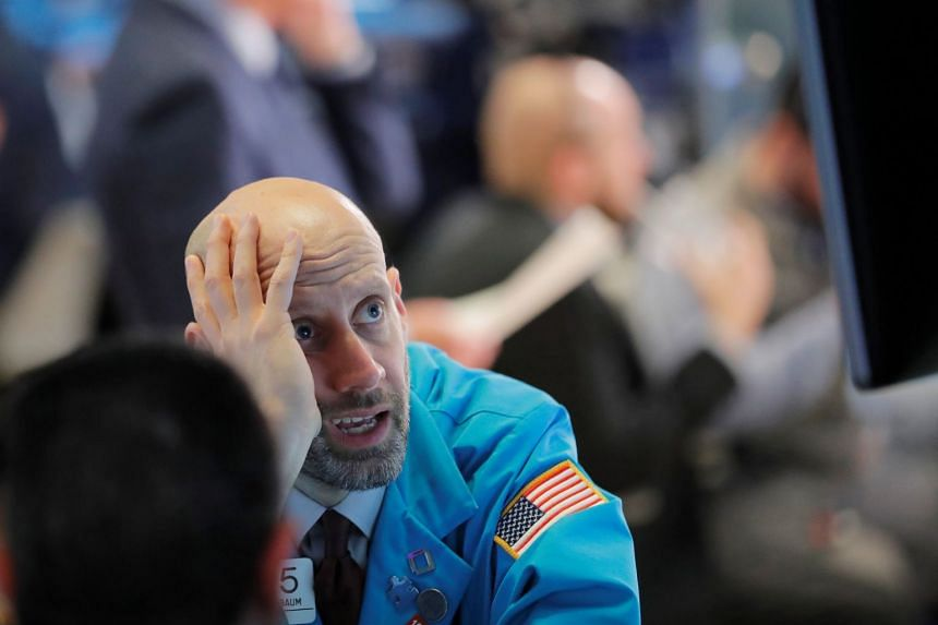 Traders work on the floor of the New York Stock Exchange shortly before the closing bell.
