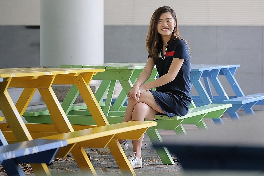 Singapore Management University undergraduate Sammie Lim Yi Xuan is packing her varsity years with not only a double degree in economics and business management, but also several co-curricular activities, overseas exchanges and internships. ST PHOTO: