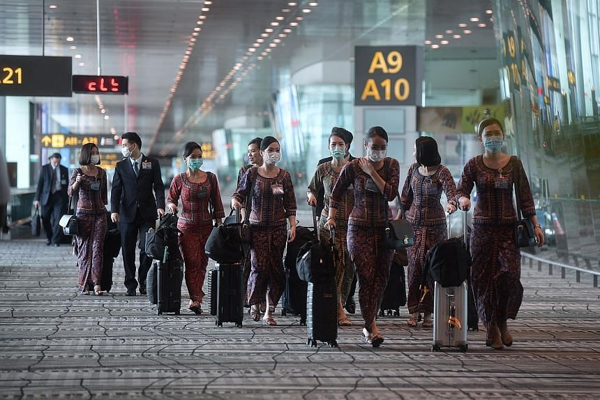 Singapore Airlines has excess manpower of more than 500 cabin crew members and about 50 pilots following three rounds of flight cuts. ST PHOTO: KUA CHEE SIONG