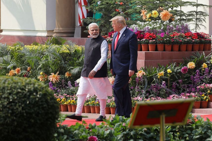 A photo taken on Feb 25, 2020, shows US President Donald Trump and India's Prime Minister Narendra Modi arrive for their joint news conference at Hyderabad House in New Delhi, India.