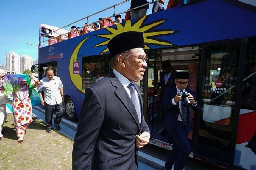 Politician Anwar Ibrahim arriving at the National Palace to meet Malaysia's King Sultan Abdullah Sultan Ahmad Shah in Kuala Lumpur, on Feb 26, 2020.