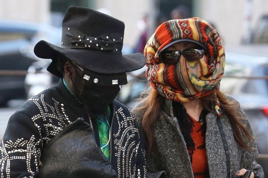 Guests wearing face masks at the Dolce and Gabbana show during Milan Fashion Week