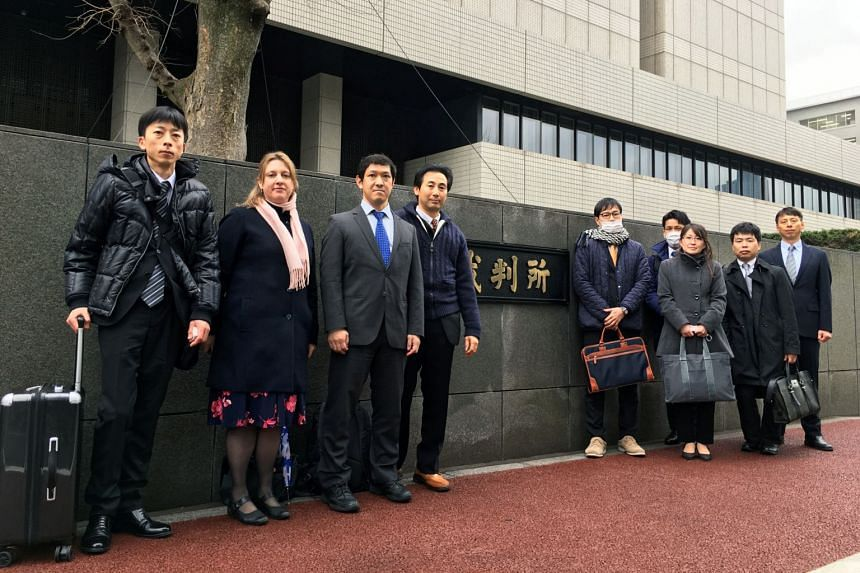 Parents estranged from their children - plaintiffs in a class-action lawsuit against the Japanese government - pose in front of the Tokyo District Court, Japan on Feb 26, 2020.
