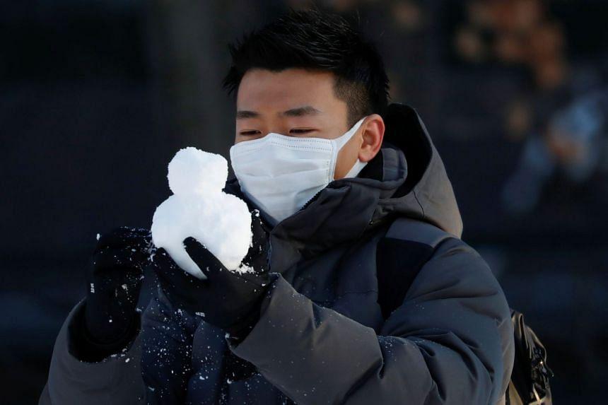 A man in Sapporo Odori Park in Hokkaido, Japan, on Feb 26, 2020. Hokkaido has Japan's highest number of confirmed coronavirus cases outside Tokyo,