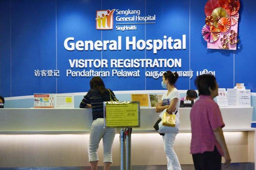 Case 92, a 47-year-old, is warded in an isolation room at Sengkang General Hospital