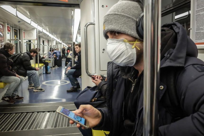 Commuters on a metro train in Milan, Italy, on Feb 25, 2020. Governments worldwide are scrambling to prevent the spread of the new coronavirus after a surge of infections in Italy, Iran and South Korea.