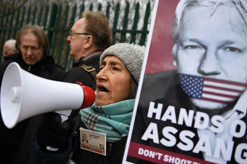 Julian Assange supporters outside Woolwich Crown Court in London.