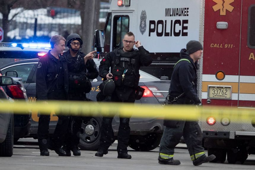 Police and emergency officials work at an active shooter scene in Milwaukee, Wisconsin.