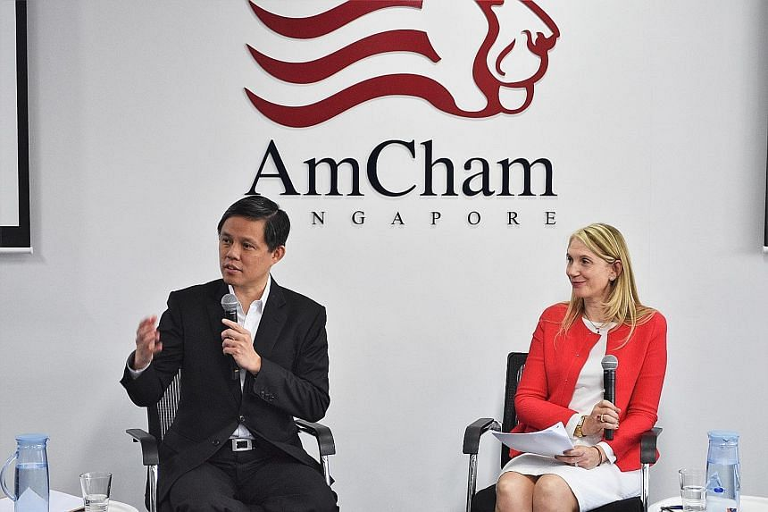 Trade and Industry Minister Chan Chun Sing with Sandpiper Communications chief executive Emma Smith at a dialogue at the American Chamber of Commerce Singapore yesterday.