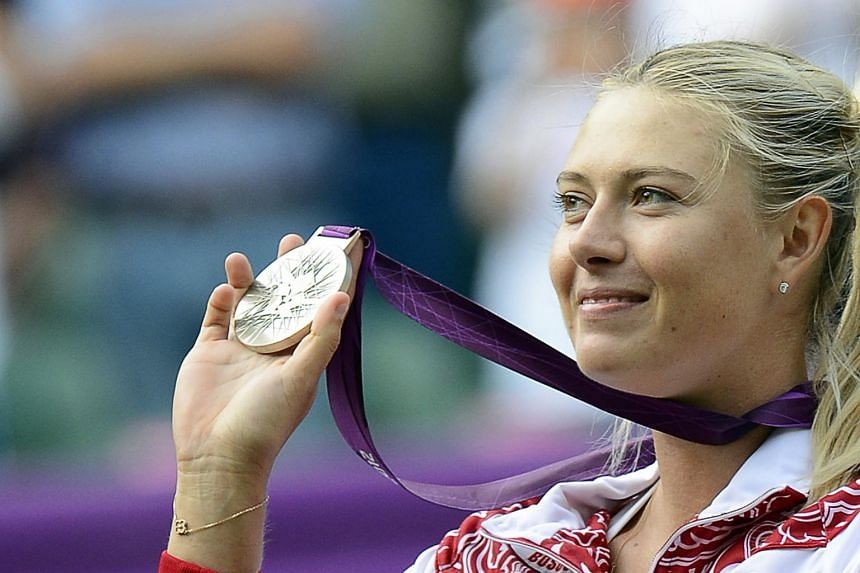 In a photo taken on Aug 2012, Russian tennis player Maria Sharapova poses with her silver medal during the medal ceremony of the London 2012 Olympic Games Tennis competition in Wimbledon.