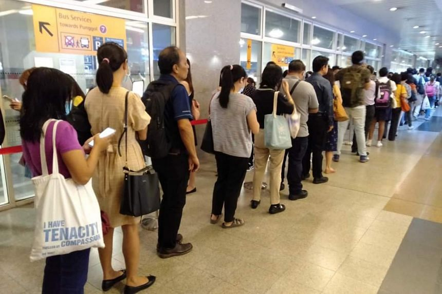 Commuters queueing at Sengkang MRT station, on Feb 27, 2020.