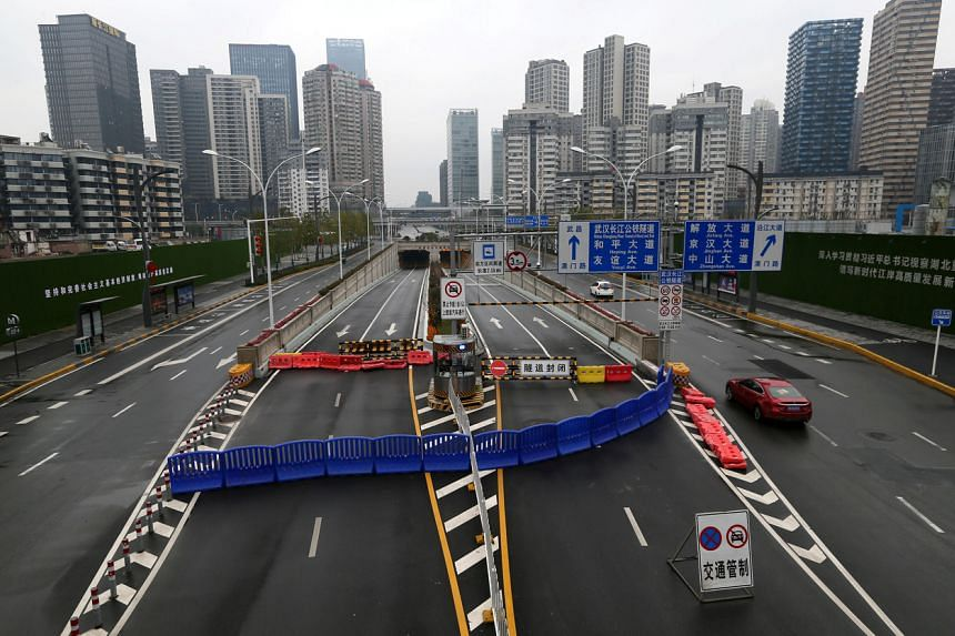 In a photo taken on Jan 25, 2020, the Wuhan Yangtze River Tunnel is blocked with a barrier following an outbreak of the coronavirus and the city's lockdown.