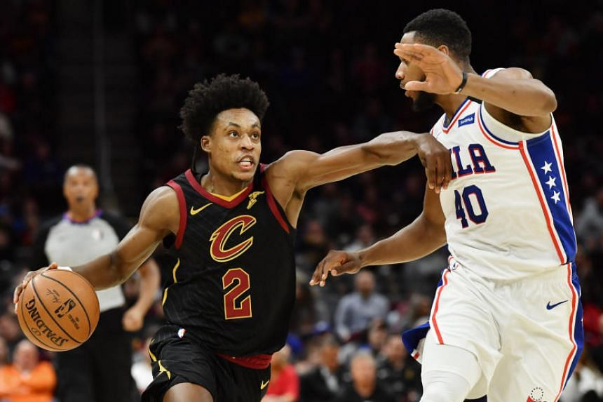 Cleveland Cavaliers guard Collin Sexton (left) drives to the basket against Philadelphia 76ers forward Glenn Robinson III during the second half at Rocket Mortgage FieldHouse, in Ohio, on Feb 26, 2020.