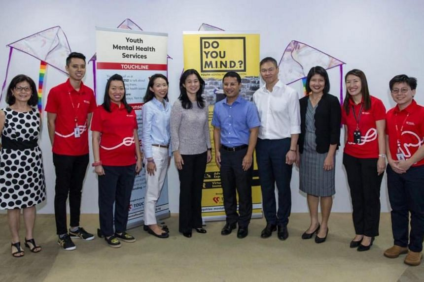 Minister for Social and Family Development Desmond Lee (fifth from right) announced in a Facebook post the formation of a Youth Mental Well-being Network which would bring together all their different views and coordinate efforts to help.