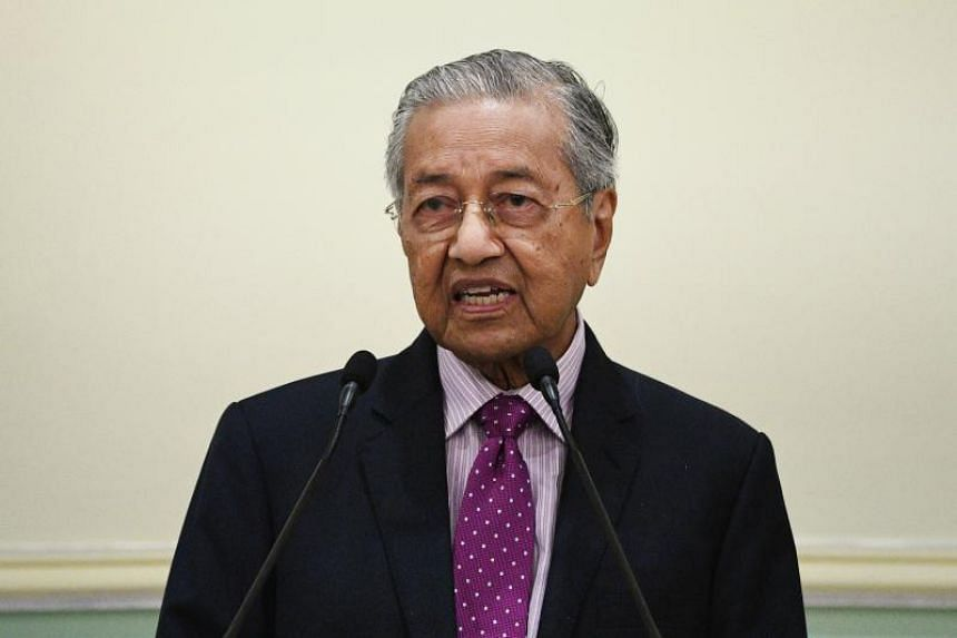 Malaysia's interim Prime Minister Mahathir Mohamad speaks as he unveils an economic stimulus plan, aimed at combating the impact from the coronavirus, at the Prime Minister's Office in Putrajaya on Feb 27, 2020.