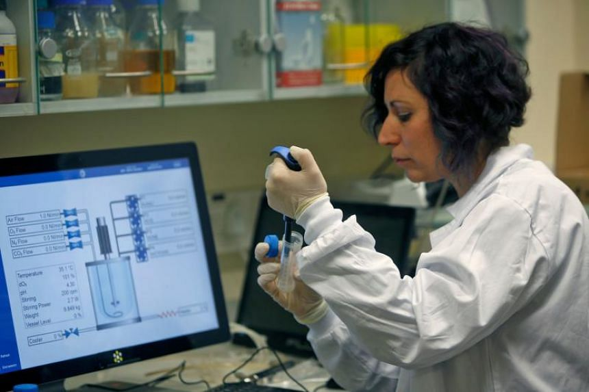 A photo taken on Feb 27, 2020 shows an Israeli scientist working at a laboratory at the MIGAL Research Institute in Kiryat Shmona in Israel.