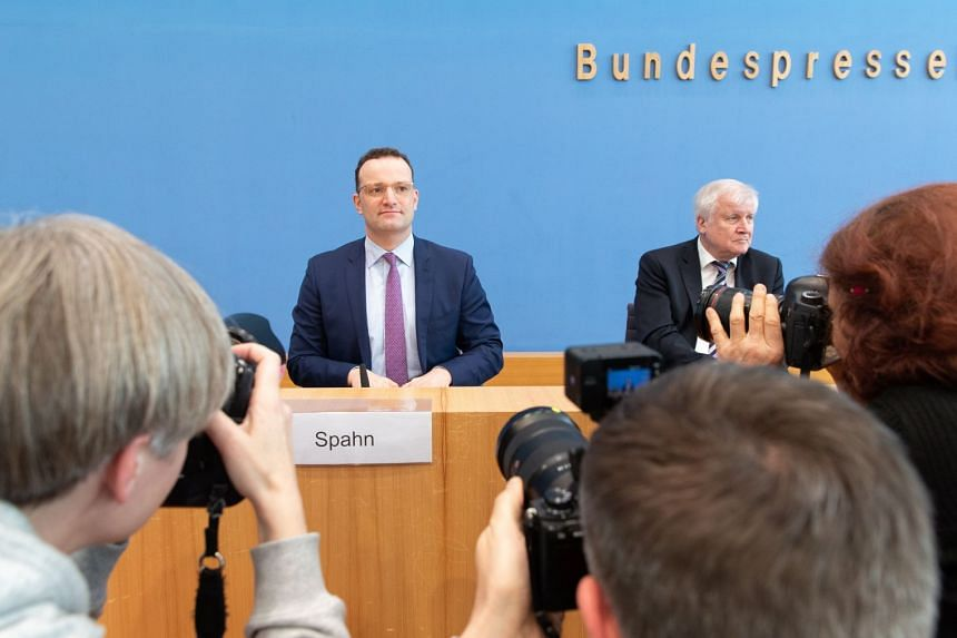 German Minister of Health Jens Spahn (left) and German Minister of Interior, Construction and Homeland Horst Seehofer (right) attend a joint press conference in Berlin.