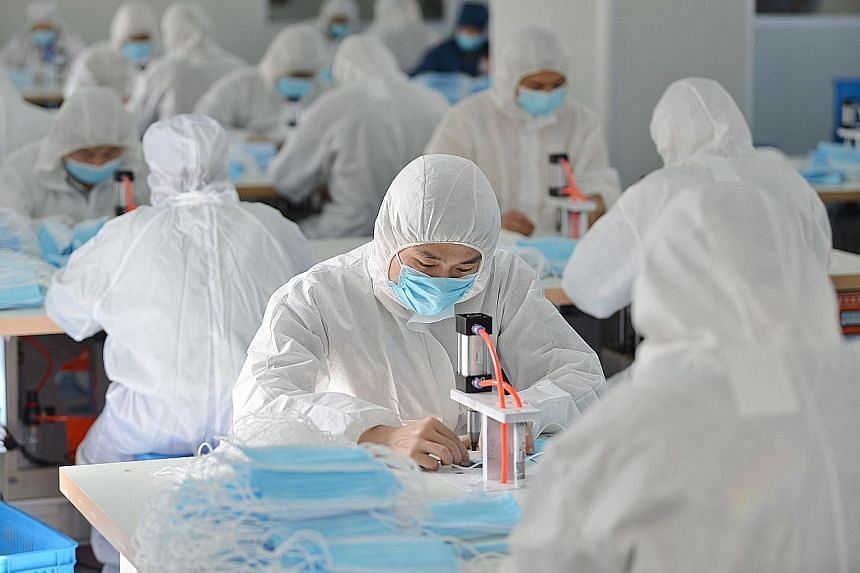 Workers making face masks last week at a factory in Nanjing, Jiangsu province, that normally makes surgical instruments and dental equipment. It is among companies in China that have revamped part of their production facilities to make masks in order