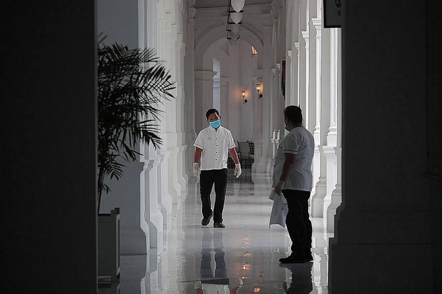 Hotels in Singapore have adopted cost-cutting measures as occupancy plummets amid the virus outbreak, including sending staff for training during the lull and shortening hours for services such as in-room dining. ST PHOTO: JASON QUAH