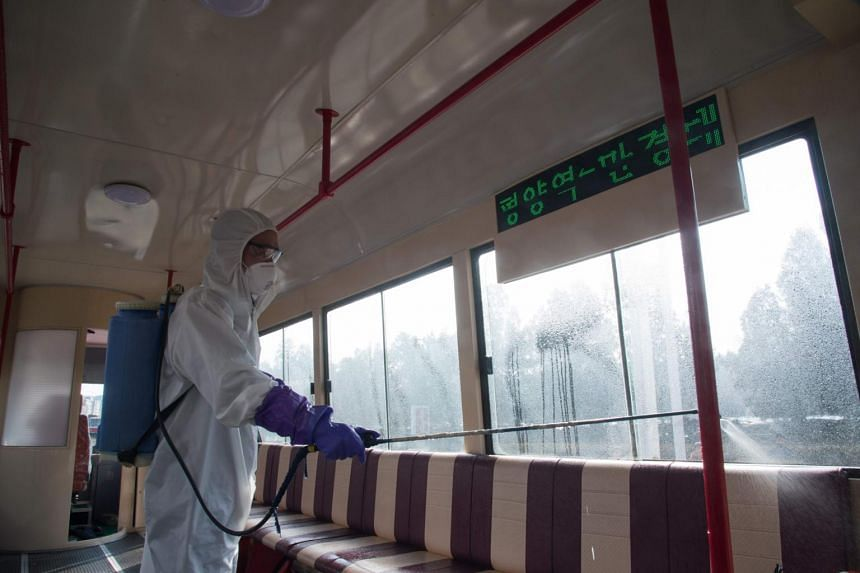 An official from the Mangyongdae District emergency anti-epidemic headquarters disinfects a tramcar to prevent the spread of the coronavirus at the Songsan Tram Station in Pyongyang on Feb 26, 2020.