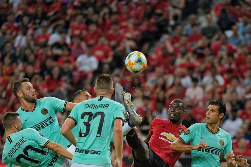 Paul Pogba of Manchester United is surrounded by several Inter players in their International Champions Cup match in Singapore on July 20, 2019, watched by 52,897 fans.