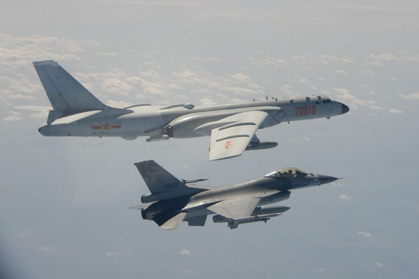 A handout photo released on Feb 10, 2020 by Taiwan's Defence Ministry shows a Taiwanese F-16 fighter jet flying next to a Chinese H-6 bomber (top) in Taiwan's airspace.