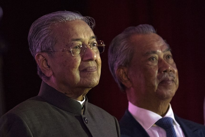 A photo taken on Feb 18, 2020, showing Malaysian Prime Minister Mahathir Mohamad (left) and Home Minister Muhyiddin Yassin at an event in Putrajaya.