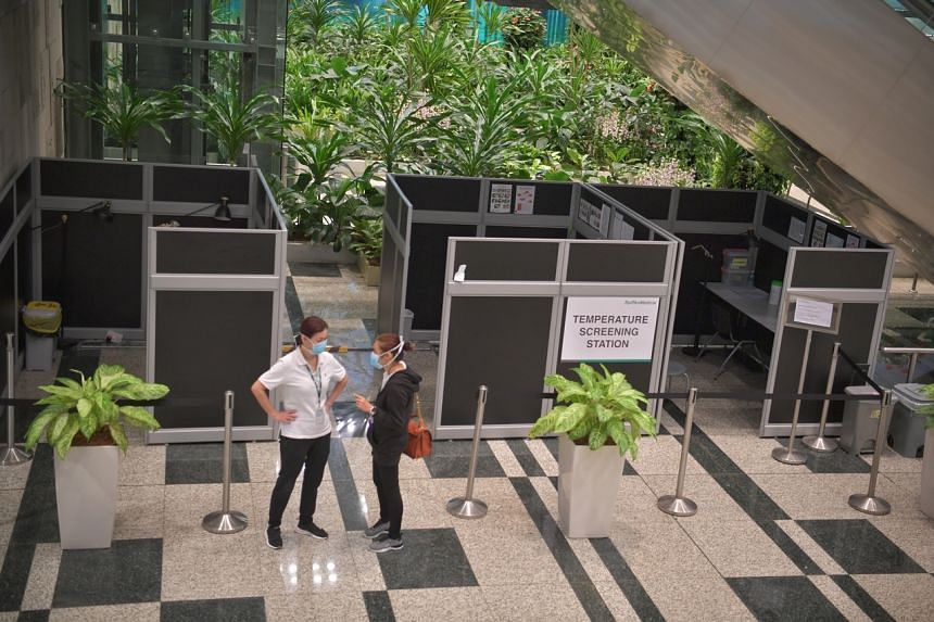 Booths set up by Raffles Medical for temperature screening at the arrival hall of Changi Airport Terminal 3.