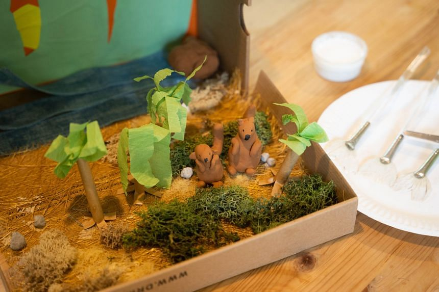 The Krafty Kids team – students Jovin Sia, Sheryl Tan, Louise Ng and Bridget Hsu – held workshops for parents and children to build kangaroo dioramas (above) together.