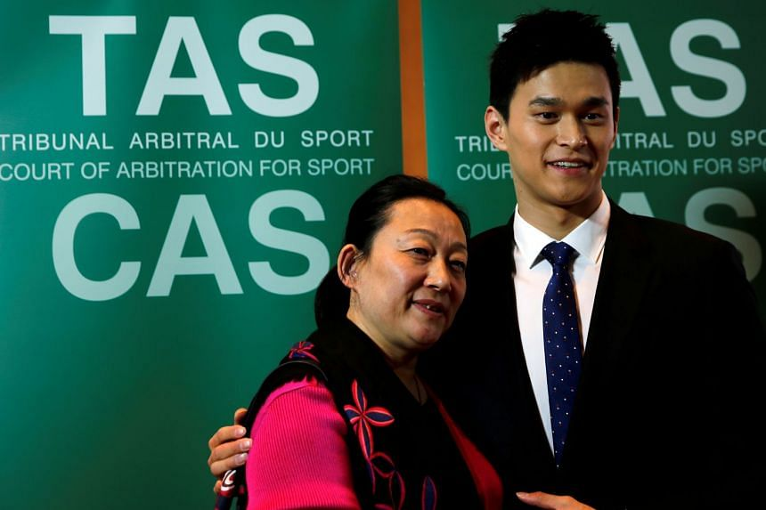 Chinese swimmer Sun Yang with his mother Ming after a public CAS hearing for the appeal filed by Wada against him and Fina in Montreux, Switzerland on Nov 15, 2019.