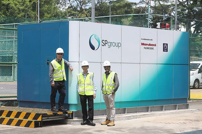 (From left) SP Group deputy director Lu Yang; Mr Goh Chee Kiong, chief executive of SP Group's new energies business; and SP Group senior engineer Sethu Sundar Pethaiah standing in front of a hydrogen energy system at its concept lab in Woodleigh.