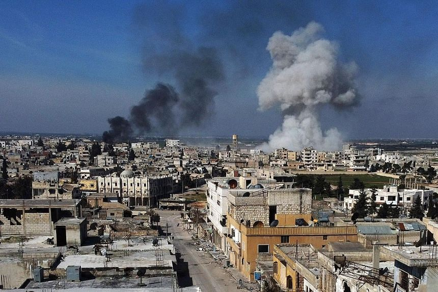 Smoke billowing over the town of Saraqib in Idlib province in north-western Syria on Thursday. At least 33 soldiers were killed in an air strike on Turkish forces in the province that day.