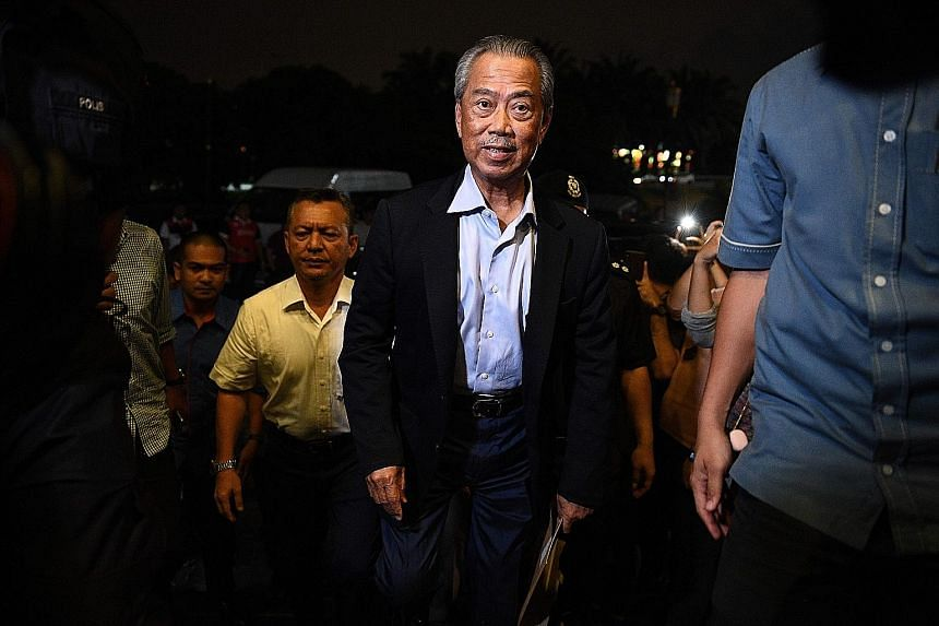"""Parti Pribumi Bersatu Malaysia president Muhyiddin Yassin arriving at the party headquarters in Kuala Lumpur on Monday. With his rise, Malaysia could have a """"backdoor government"""". PHOTO: AGENCE FRANCE-PRESSE"""