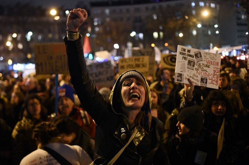 A feminist activist shouts slogans and gestures during a demonstration outside the Salle Pleyel in Paris as guests arrive for the 45th edition of the Cesar Film Awards.