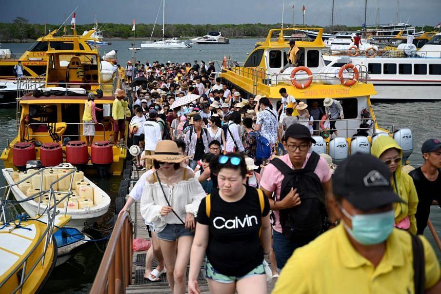 Chinese tourists arriving at a boat pier on Serangan island in Denpasar, Bali, on Jan 26, 2020, .