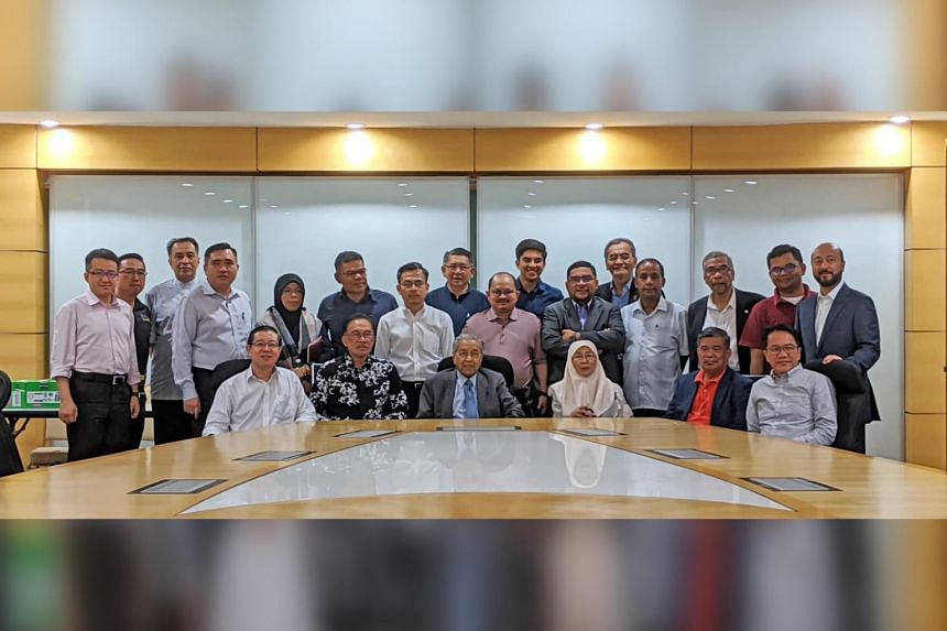 Tun Dr Mahathir Mohamad and other PH leaders after a PH meeting on Feb 29, 2020, where he announced that he has the support of 114 MPs for the position of PM.