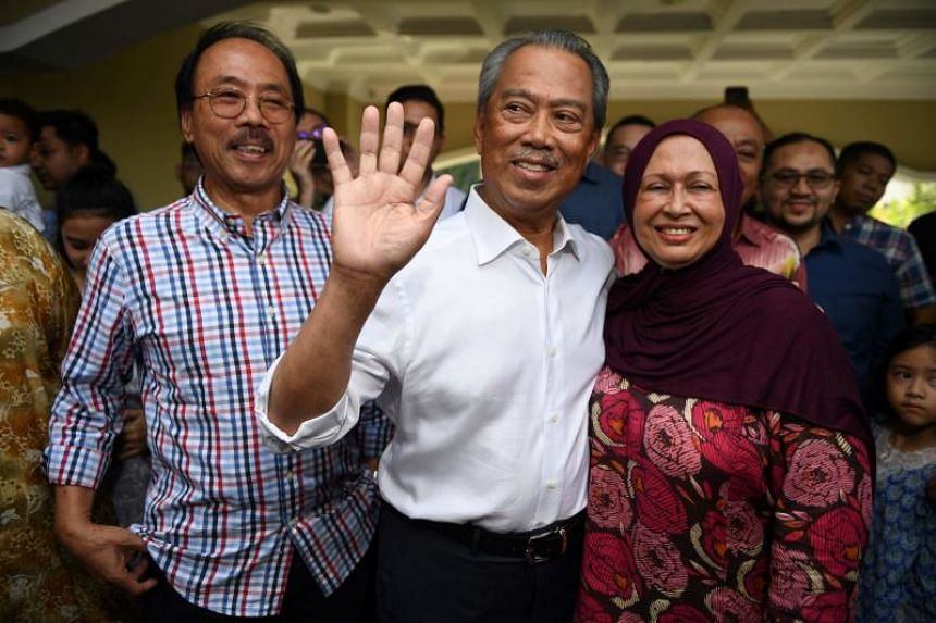 Mr Muhyiddin with his wife Noraini Abdul Rahman outside their home on Feb 29, 2020.