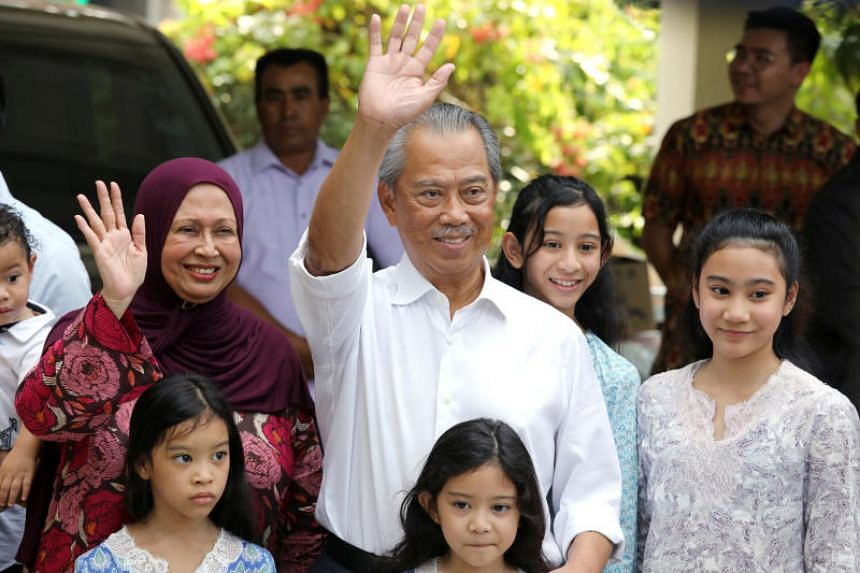 Tan Sri Muhyiddin Yassin (centre) and his family waving to the press outside his home in Kuala Lumpur on Feb 29, 2020. Malaysia's King has picked him as prime minister.