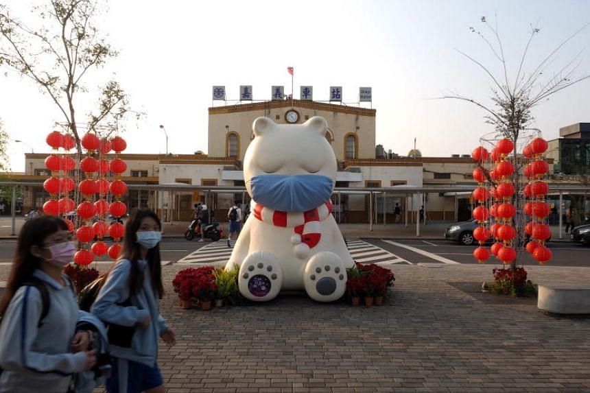 An art installation of a bear wearing a mask is seen in Chiayi, Taiwan, on Feb 27, 2020.